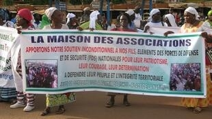 Women march against terrorism in Ouagadougou, Burkina Faso, 12 October 2018.