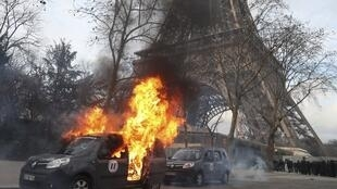 "A Sentinelle security operation car burns in front of the Eiffel Tower, on the sidelines of a demonstration in Paris on February 9, 2019, as the ""Yellow Vests"" (Gilets Jaunes) protesters took to the streets on February 9th."