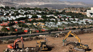 Work resumes after the 27 September lifting of the settlement freeze