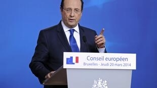 Francois Hollande at a European Union leaders summit in Brussels March 21, 2014