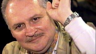 Carlos the Jackal gives a cleched-fist salute during his trial