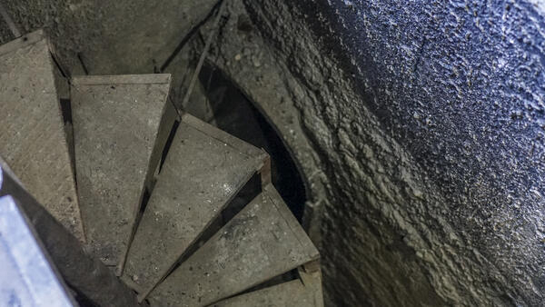 Stairs leading down into a tunnel