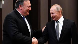 Госсекретарь США Майк Помпео и президент РФ Владимир Путин в Сочи, 14 мая 2019.