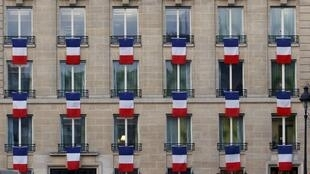 A building near the Invalides, showing french flags as requested by the government