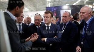 French President Emmanuel Macron visits a stand at Euronaval, the world naval defence exhibition in Le Bourget near Paris, France, October 23, 2018.