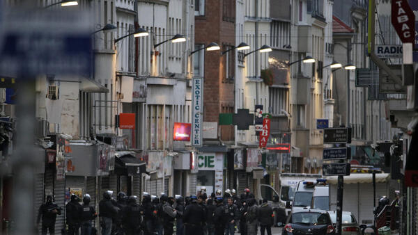 In this file picture taken on November 18, 2015 Police officers gather in the northern Paris suburb of Saint-Denis city centre, as French Police special forces raid an appartment, hunting the perpetrators of the Paris attacks