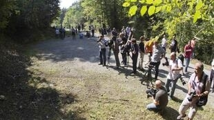 Journalists at the scene of the murders near Chevaline in the french Alps
