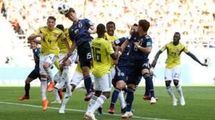 Cầu thủ Nhật Bản Yuya Osako nhảy lên đánh đầu vào lưới của Colombia trong trận đấu vòng loại, bảng H,ngày 19/06/2018 tại Cúp Bóng Đá Thế Giới.