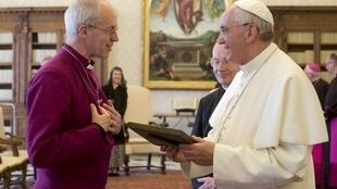 Pope Francis exchange gifts with the Archbishop of Canterbury Justin Welby during a private audience at the Vatican, 14 June, 2013