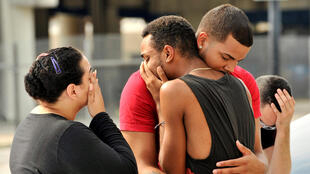 Relatives of the victims gather outside the police headquarters in Orlando, hours after the shooting.
