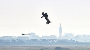 "Franky Zapata stands on his jet-powered ""flyboard"" after he took off from Sangatte, northern France, on August 4, 2019, in an attempt to fly across the 35-kilometre (22-mile) Channel crossing in 20 minutes, while keeping an average speed of 140 kmph"