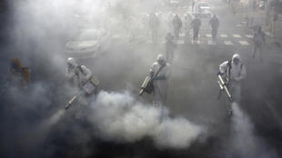 Iranian firefighters disinfect streets in the capital Tehran in a bid to halt the wild spread of coronavirus