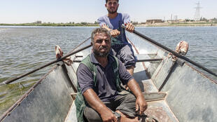 Mohammad Abdulla rows across the Euphrates river.