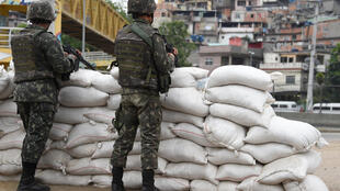 Brazilian military forces stand guard in the streets of Mare