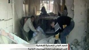 TV images of men clearing debris from a building after Damascus attacks