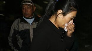 Sujata Shrestha, mother of an air stewardess, cries while inquiring at  Yeti Airlines in Kathmandu