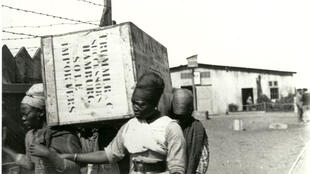 Herero women forced to transport merchandise in Swakopmund camp.  Ca.1905-1907.