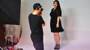 South Korean plus-size model Vivian Geeyang Kim poses for a photo shoot at a studio in Seoul.