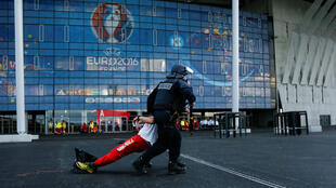 French Police forces take part in a mock attack drill outside the Grand Stade stadium (aka Parc Olympique Lyonnais or the Stade des Lumieres) in Decines, near Lyon, France, in preparation of security measures for the UEFA 2016 European Championship May 30,