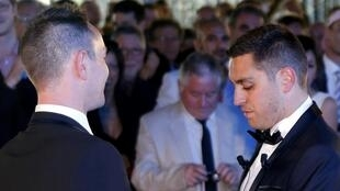 Bruno Boileau (R) and Vincent Autin (L) become France's first gay married couple in Montpellier in May