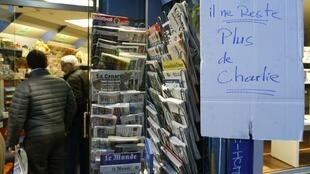 """No more Charlie"" says this sign on a Paris newsstand Wednesday"