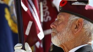 A war veteran takes part in a service to mark the 97th anniversary of Australian and New Zealand Army Corps Day