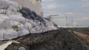 A temporary barrier in front of the Fukushima nuclear plant at the end of June
