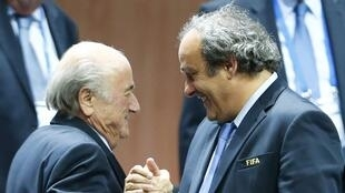 Michel Platini (R) with Sepp Blatter on Friday