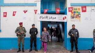 Police in front of a polling station in Tunis during first round of the Presidential election on 23 November 2014. Tunisia goes to polls on 15 September 2019.