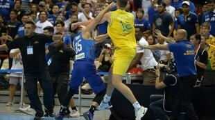 Mathew Wright (L) of the Philippines and Daniel Kickert of Australia exchanging blows in a brawl during their FIBA World Cup Asian qualifier game at the Philippine arena in Bocaue town, Bulacan province, north of Manila on July 2, 2018.