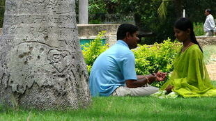 Couple in the garden outside Somnathpur Temple, near Mysore, India