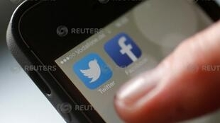 An illustration picture shows a man starting his Twitter App on a mobile device in Hanau near Frankfurt, October 21, 2013.