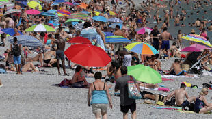 Parasols dot a crowded beach of sunbathers in Nice as summer temperatures continue and authorities maintain a heat wave alert in France, August 1, 2018.