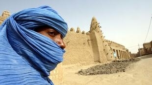 A Tuareg in front of the 13th-century mosque in Timbuktu, seized by rebels this week