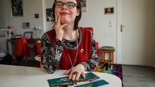 Eléonore Laloux, a young woman with Down syndrome, poses at her home in Arras, northern France, on 13 February, 2020.