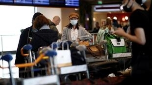 Tourists from an Air China flight from Beijing arrive at Charles de Gaulle airport in Paris.