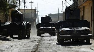 Iraqi troops in Mosul in March