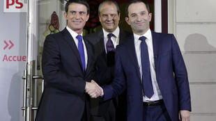 Manuel Valls (L) and Benoît Hamon on Sunday