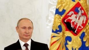 O presidente russo, Vladimir Putin, durante discurso diante do parlamento russo, em Moscou, nesta terça-feira (18).