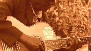 Abana ba Nasery Band's musician playing the Omutibo music