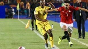 Egypt's Trézéguet (right) scored the winner against Zimbabwe.