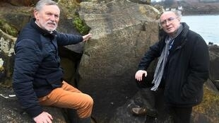 Co-winners: French linguist Noël René Toudic, left, and author Roger Faligot stand beside the engraved rock near Plougastel-Daoulas in the French region of Brittany.