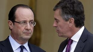 Президент Ф.Олланд и экс-министр бюджета Жером Каюзак