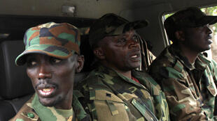 Congolese Revolution Army rebel leader Sultani Makenga (L) sits in a truck in Goma, 20 November, 2012