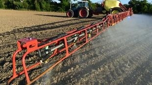 Roundup glyphosate herbicide sprayed on a field in France