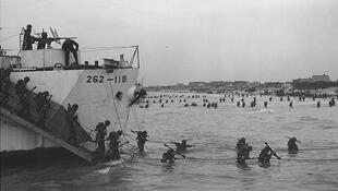 Canadian soldiers disembark at Juno Beach in 1944