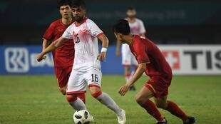 Cấc cầu thủ Olympic Việt Nam (áo đỏ) trong trận thắng Bahrain 1-0,  vào tứ kết lần đầu tiên trong lịch sử ở đấu trường Asiad, ngày 23/08/2018 tại Bekasi, Indonesia.