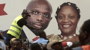 An electoral poster showing George Weah and Jewel Howard Taylor. Picture taken on 29 December, 2017, outside of their campaign headquarters in Monrovia.
