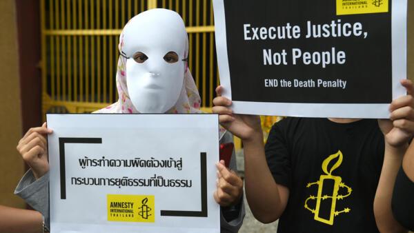 Ativistas da Anistia Internacional protestam contra execuções de detentos em Bangkok, na Tailândia. Junho 2018