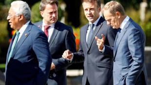 Da esq. para a dir., o premiê português Antonio Costa, o premiê de Luxemburgo, Xavier Bettel, o presidente francês Emmanuel Macron e o presidente do Conselho Europeu, Donald Tusk, durante cúpula informal na Áustria, em 20 de setembro de 2018.